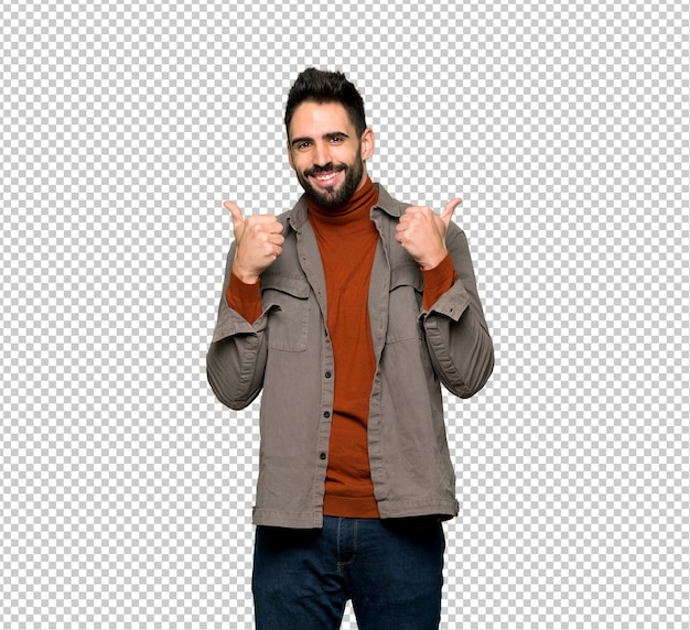 Bell'uomo con la barba dando un pollice in alto gesto con entrambe le mani e sorridente