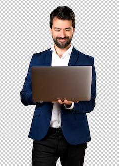 Bell'uomo con laptop
