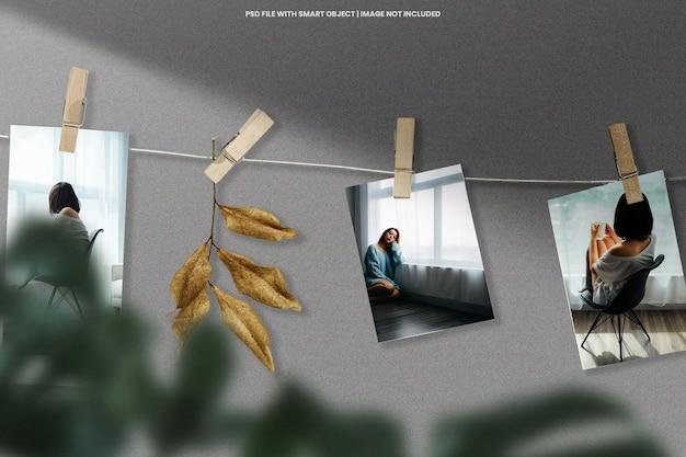 Mockup modello polaroid con cornice per foto appese psd premium