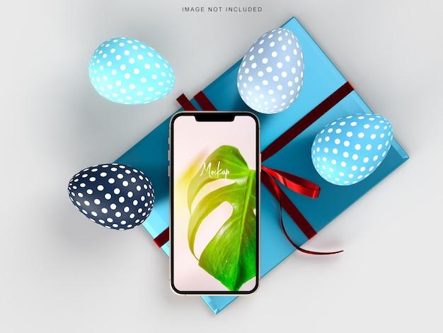 Buona pasqua! smartphone creativo di mockup di vacanze di pasqua