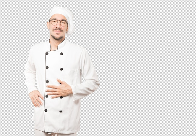 Felice giovane chef pensando al cibo