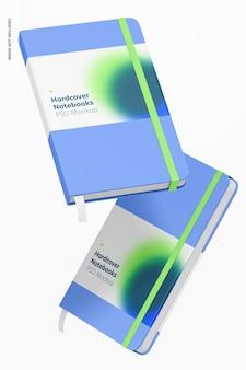 Quaderni con copertina rigida con fascia elastica mockup, caduta
