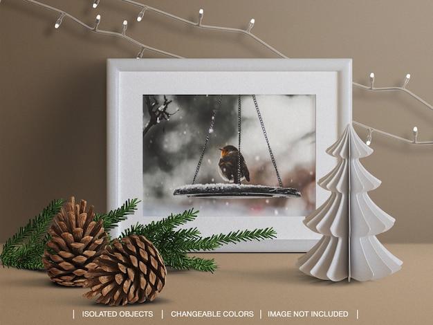 Mockup di cornice per foto di auguri natalizi e creatore di scene con ramo