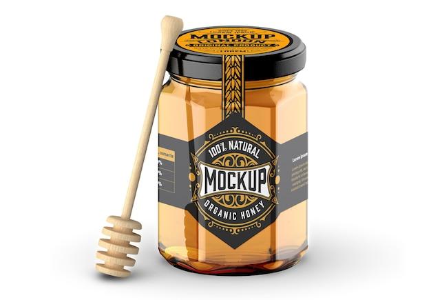 Barattolo di vetro di miele con cucchiaio mockup isolato