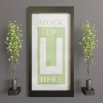 Mockup cornice orizzontale sul muro. mockup cornice nera per banner o opere d'arte
