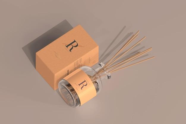 Bottiglia di vetro con diffusore a lamella per deodorante per ambienti di incenso con mockup di scatola