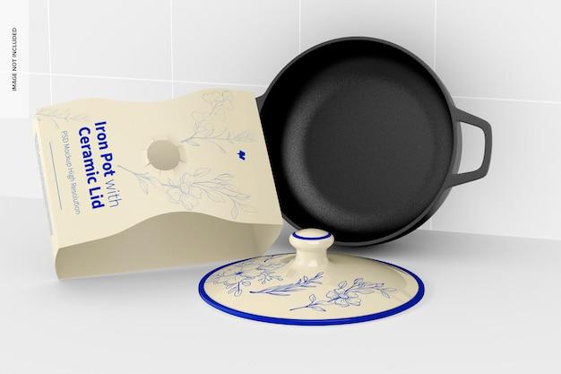 Pentola in ferro con coperchio in ceramica mockup, appoggiata