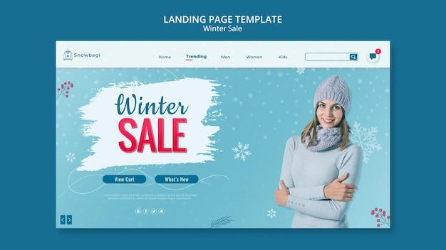 Modello di pagina di destinazione per la vendita invernale con donna e fiocchi di neve
