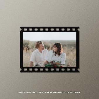 Mockup di frame di pellicola di carta nera di paesaggio