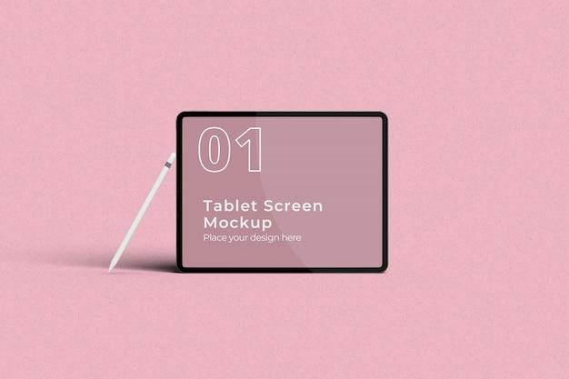Mockup di schermo tablet paesaggio con vista frontale della matita