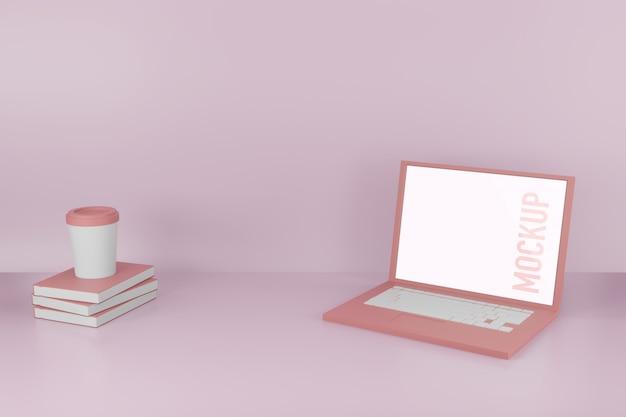 Computer portatile con una tazza di caffè sul modello di libri