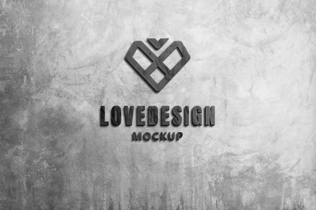 Modello di logo che intaglia marmo nero 3d sul muro di cemento grigio scuro.
