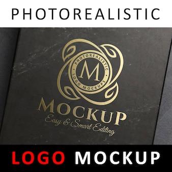 Logo mockup - logo a stampa a foglia d'oro su scatola nera