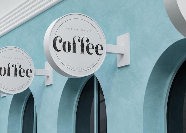 Segno circolare bianco di mockup di logo sul negozio moderno