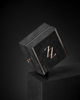 Modello di scatola nera di lusso per gioielli o confezione regalo su sfondo nero astratto 3d render