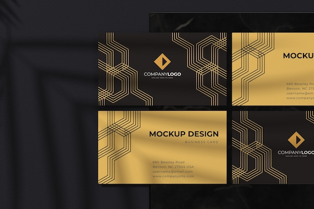 Mockup di design di lusso biglietto da visita nero con linee geometriche dorate