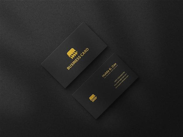 Modello di biglietto da visita nero di lusso con effetto goffrato oro