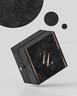 Il modello nero di lusso del contenitore di regalo su fondo astratto bianco per l'identità di marca 3d rende