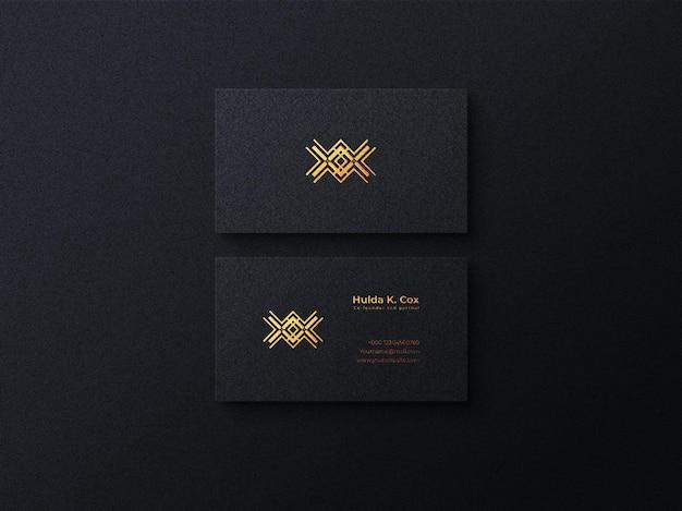 Modello di biglietto da visita scuro di lusso con effetto in rilievo e modello di logo oro di lusso