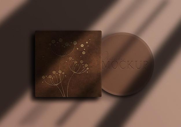Mockup di scatola per il trucco di lusso in rilievo dorato