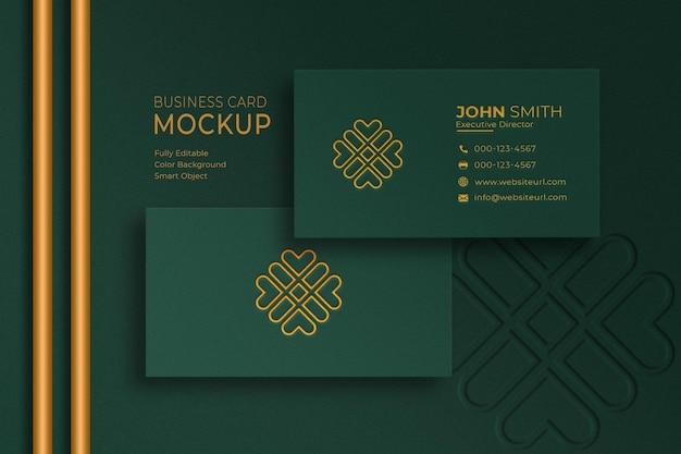 Mockup di biglietti da visita di lusso verde e oro