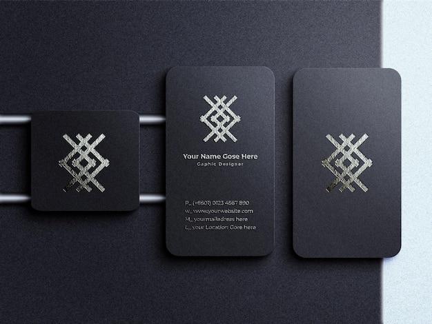 Modello di logo di lusso e moderno su biglietto da visita verticale e sfondo scuro