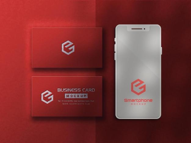 Mockup di biglietto da visita rosso di lusso con smartphone