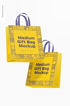 Sacchetti regalo medi con manici in nastro mockup, galleggianti