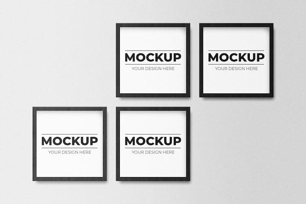 Mockup di foto cornice nera quadrata vuota minima che appende sul fondo bianco della parete