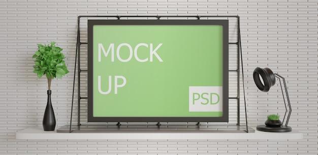 Mockup di cornice paesaggistica minimalista sul tavolo a muro