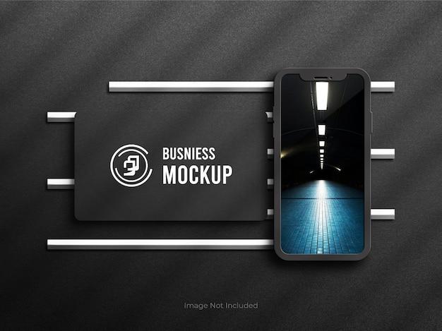 Mockup di telefoni cellulari con carta busniess psd