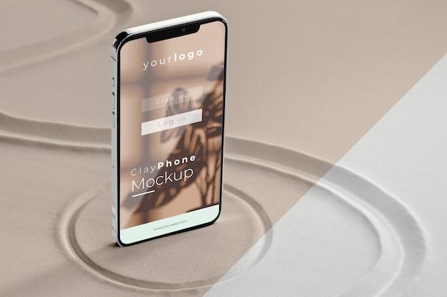 Smartphone mock-up in assortimento di sabbia