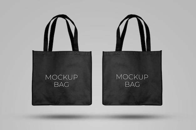 Mockup nero tote bag in tessuto per lo shopping