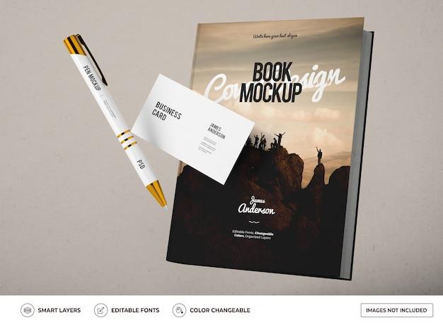 Mockup di libro con biglietto da visita e design a penna