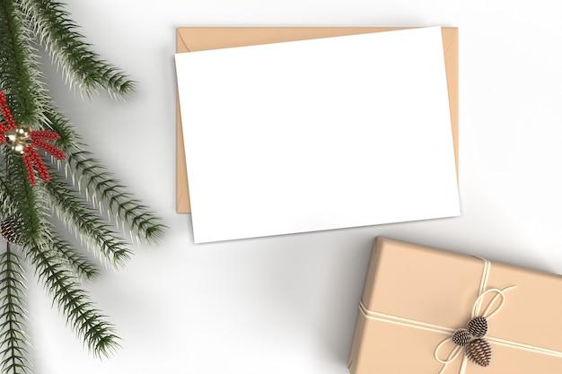 Mockup di carta natale con decorazioni e rami di abete