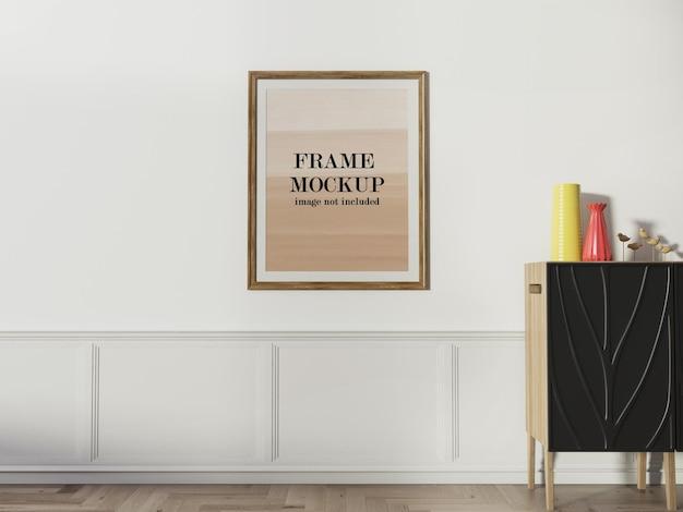 Mockup frame sulla parete per il tuo design