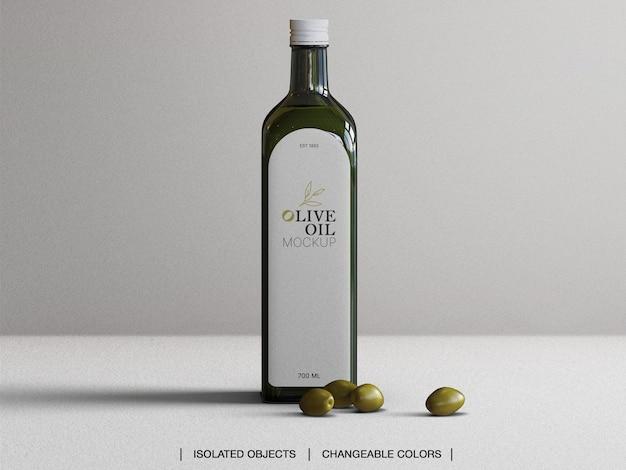 Mockup di bottiglia di vetro di olio d'oliva vista frontale con olive