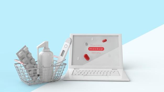 Schermo del monitor del laptop mockup e carrello della spesa con prodotti formassettici - pillole, spray e termometro. illustrazione 3d
