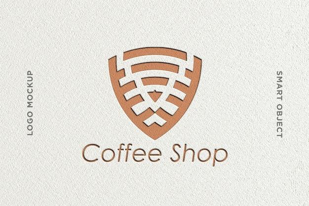 Mockup logo deboss caffè con sfondo bianco