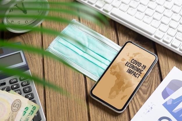 Telefono cellulare mockup per covid 19 impatto economico e commerciale