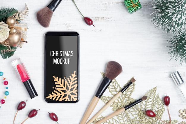 Smartphone di mockup per il concetto di bellezza natale capodanno