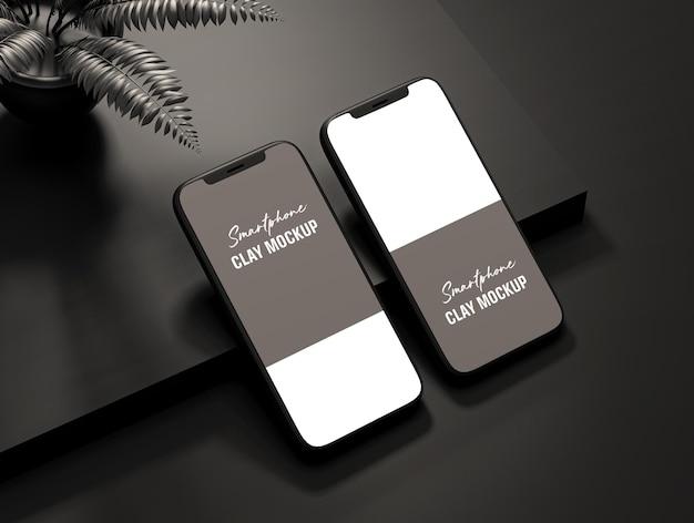 Vista isolata del design moderno del mockup dello schermo del telefono in argilla blac psd premium