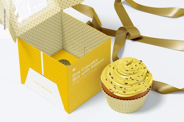 Una scatola per cupcake con nastro mockup, da vicino