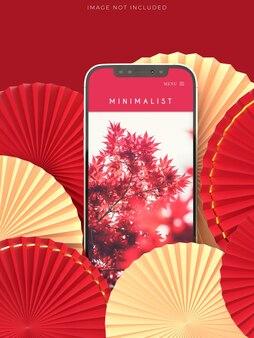 Medaglione di ventaglio di carta come decorazione del capodanno cinese con mockup del telefono