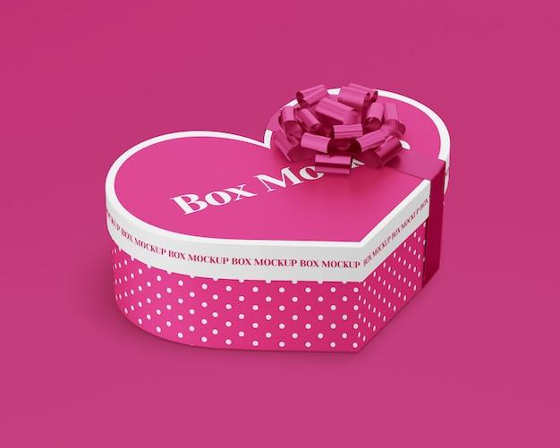 Contenitore di regalo di carta cuore con nastro