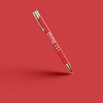 Mockup di penna per merchandising su sfondo rosso