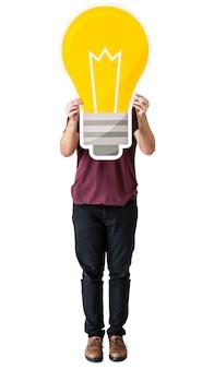 Persone con icona della lampadina