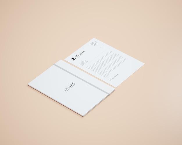 Prospettiva sketchbook e carta a4 mockup