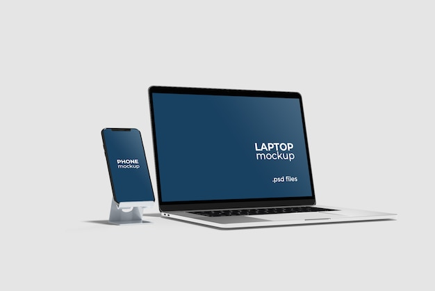 Telefono con supporto e laptop mockup