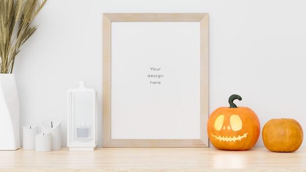 Mockup di cornice foto sul tavolo con decorazioni di halloween